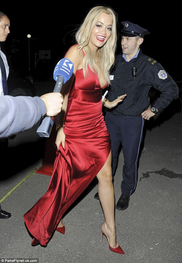 RED Hot Right Now: Rita Ora put on a wildly glam display in a thigh-split gown as she stepped out to a wedding in her native Kosovo on Friday night