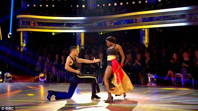 Fighting it out: Olympic boxer Anthony Ogogo and Oti Mabuse were dancing the Pasodoble to the theme of Rocky III - where the set was made to look like a boxing ring