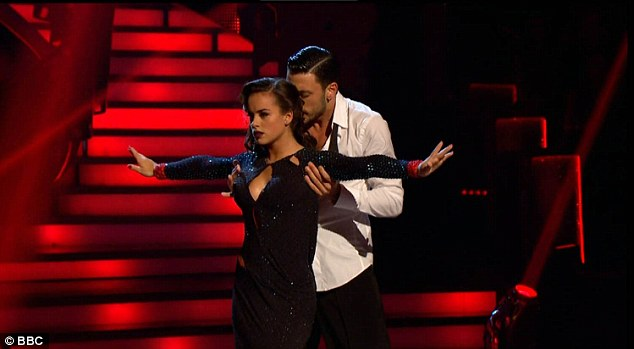 Sensual:Coronation Street star Georgia May Foote did her best Bond girl impression with Giovanni Pernice danced the Rumba to Sam Smith's recent James Bond hit Writing's On The Wall from the movie Spectre