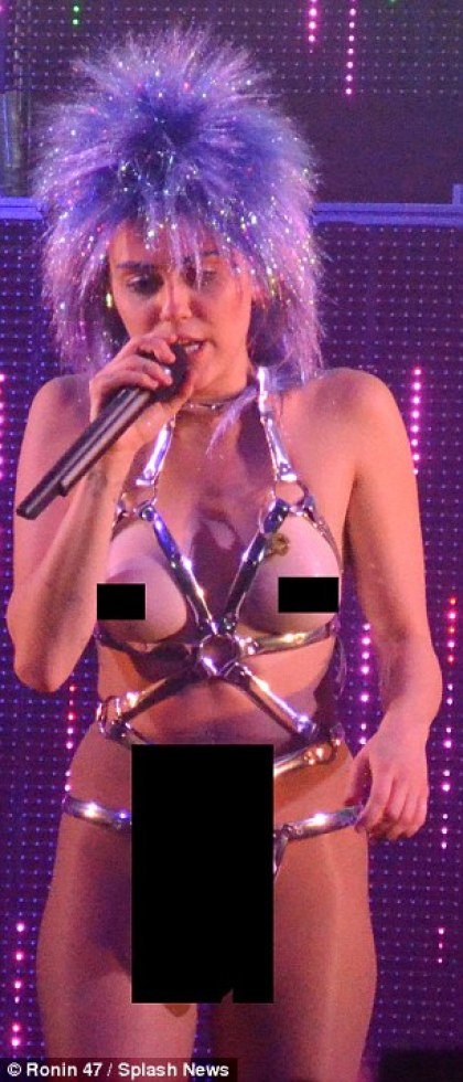 Miley Cyrus wears fake breasts at live concert milky milky milk tour