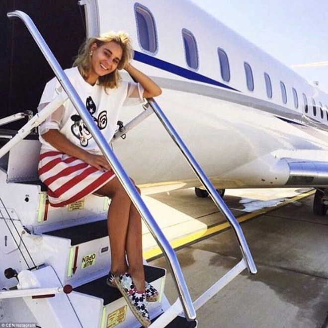 Many of the photographs show them posing for pictures next to expensive private jets. This woman is said to be Anya Udodova from Moscow