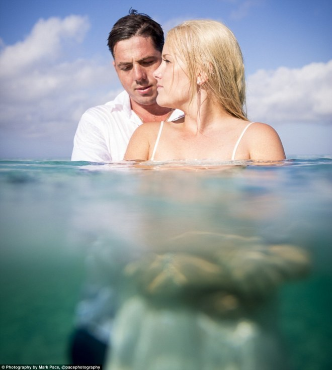 New dress: The dress wasn't damaged at all and the happy couple were snapped holding hands in crystal clear water, surrounded by picturesque scenery