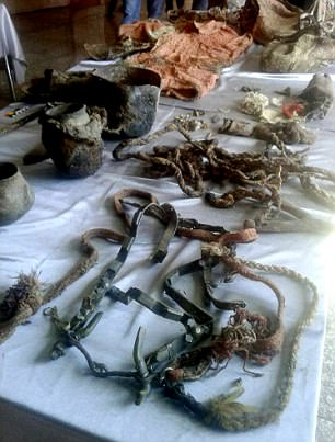A host of possessions were found in the grave including included a bridle, clay vase, wooden bowl, trough, iron kettle (all pictured), the remains of a horse, and ancient clothing