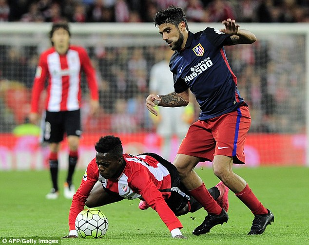 Augusto Fernandez (right) has slotted into Atletico's midfield and suits Simeone's style of football