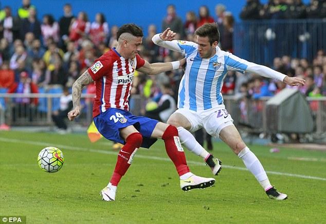 Tenacious Argentinian defenderJose Maria Gimenez (left) faces a physical battle against the striker
