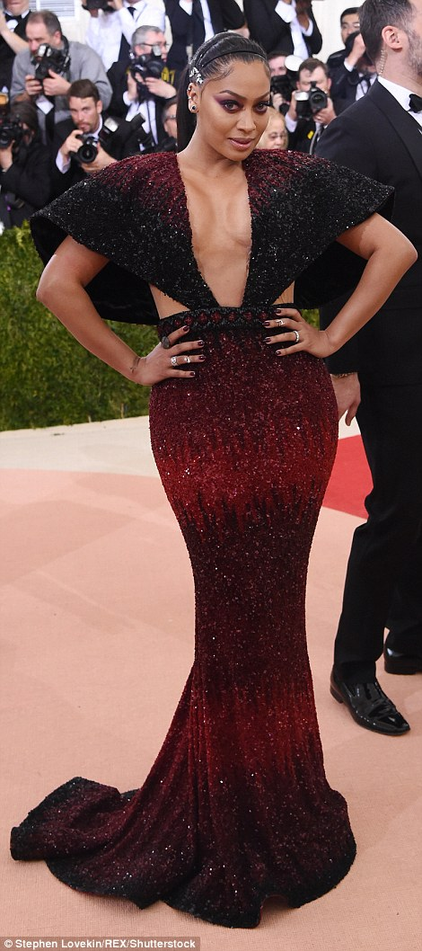 Full on: LaLa Anthony's bust seemed to defy gravity in this red and black gown, while her make-up and hair accessories were confusing