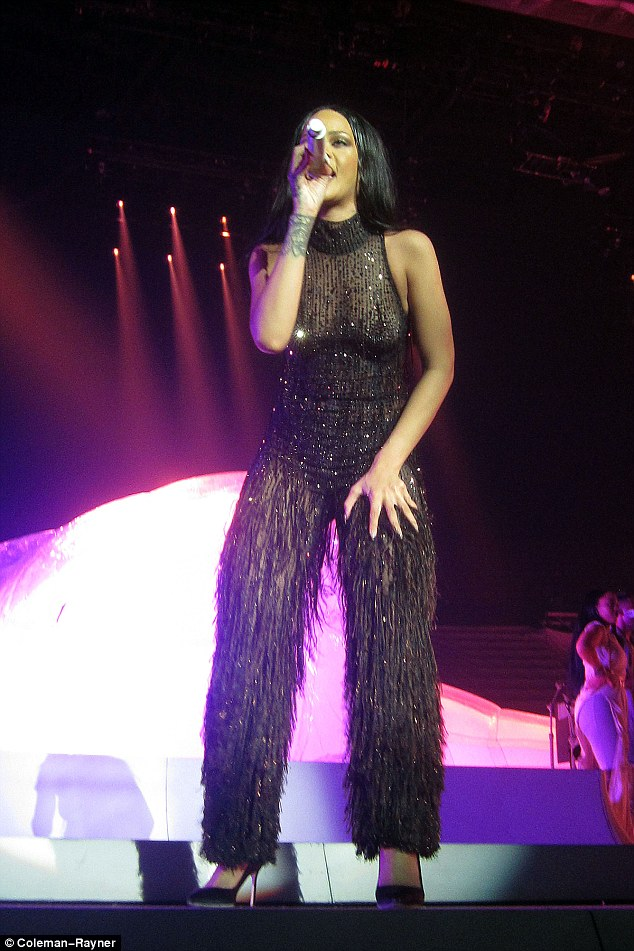 Wowzers!The 28-year-old songstress put on, arguably, her sexiest show to date as she bent double in a pair of chaps before flashing her entire chest in a sheer ensemble