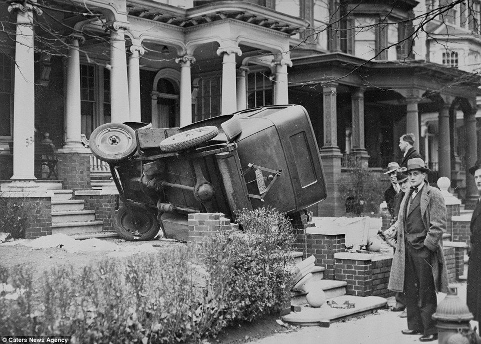 This shot captures an accident that took place as a woman was being rushed to hospital, the car taking her to get treatment jumped a curb and careered into the steps of a nearby house
