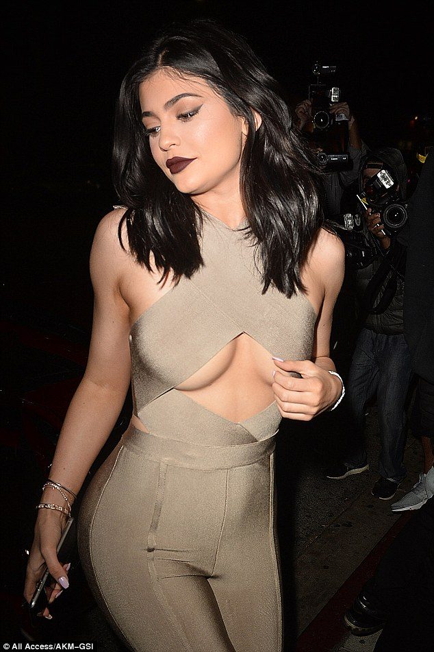 Oh my goodness: Kylie Jenner really pulled out all the stops when she headed out on Thursday in a gravity-defying nude jumpsuit as she headed to The Nice Guy in West Hollywood