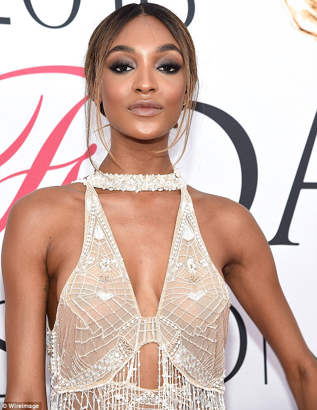 Elegant: Jourdan sported shimmery smokey eye makeup with pink blush and nude lipstick, all by Maybelline