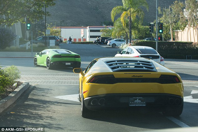 Zoom, zoom: The For the Road singer drove off down Ventura Boulevard in Calabasas and his pal followed in the yellow Lamborghini bearing CLM plates