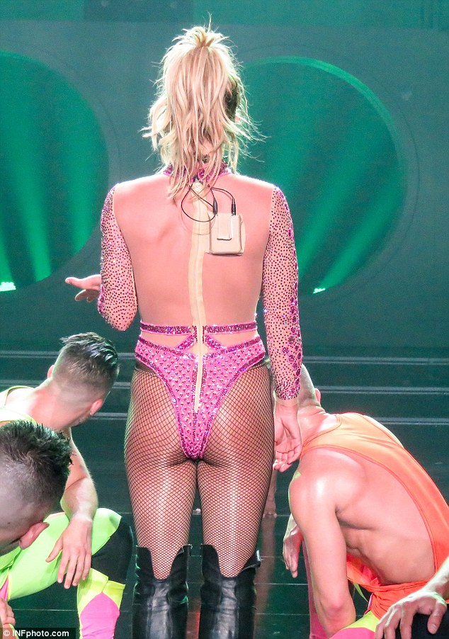 Getting cheeky! A shimmery, pink backless number showed off Britney's pert derriere