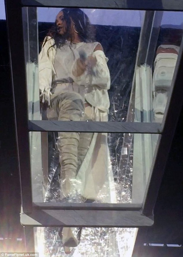 Confident: Only moments before she became visibly emotional at her Dublin gig on Tuesday night, Rihanna appeared to be in her usual sassy and saucy mood as she cavorted across a suspended glass walkway
