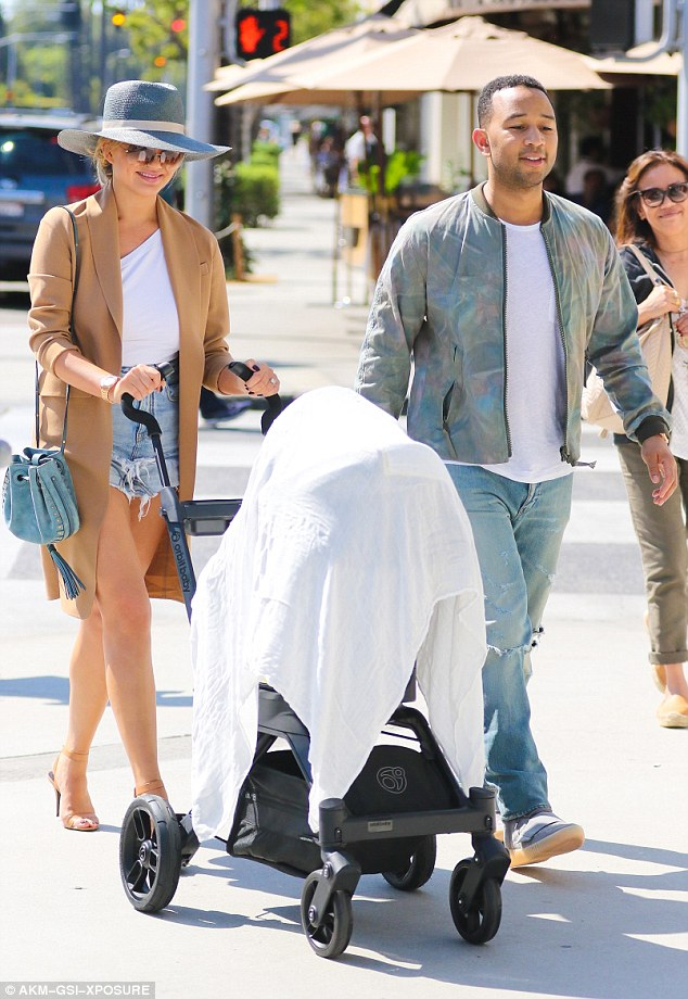 Family outing: Chrissy Teigen turned heads as she stepped out with husband John Legend and their baby daughter Luna in Beverly Hills on Wednesday