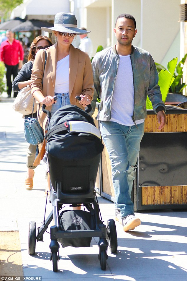 How are you doing in there? Chrissy kept watch on her little two-month-old while John looked fashion-forward in ripped jeans, T-shirt, bomber jacket and Yeezy shoes