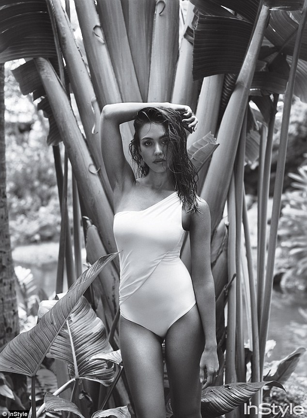 Sultry: The 35-year-old actress and Honest Company founder poses in a white Chanel swimsuit amid tropical surroundings