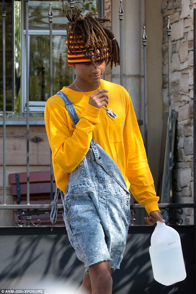 Nineties-inspired ensemble: The son of Hollywood A-listers Will Smith and Jada Pinkett wore a bright yellow shirt and acid wash overalls