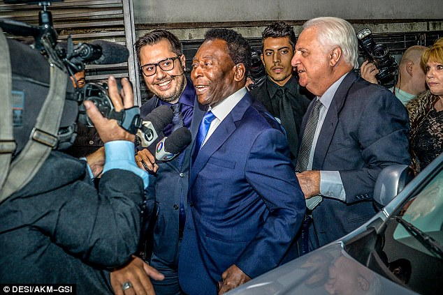 Good times: Pele looked like he was having the best time as he left the building post-ceremony