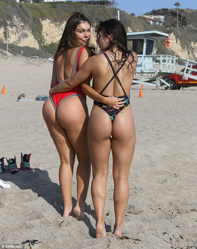 Double trouble! The Brazilian bombshell gave beachgoers an eyeful as she posed up up a storm with her gorgeous gal pal