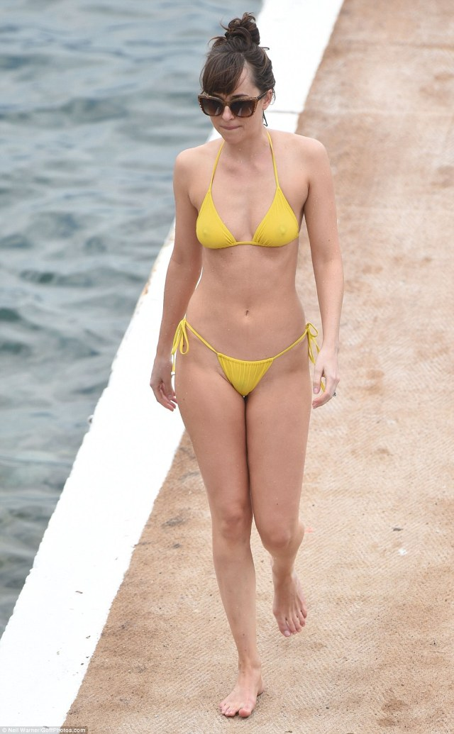 Fun in the sun! Dakota ensured that tan lines were kept to a minimum with extremely risky string bikini pants that she tied in cute bows at the sides