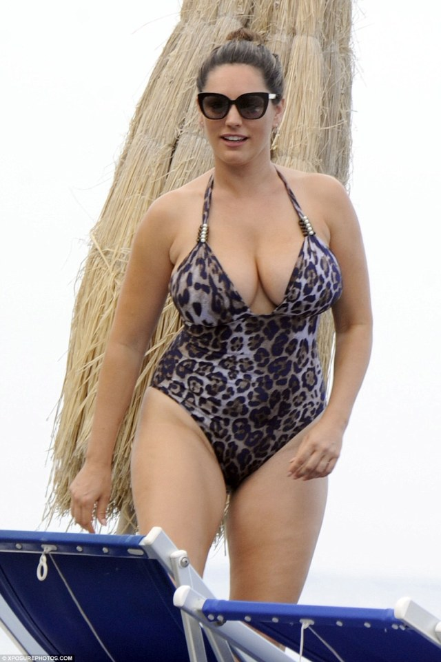 Beach ready: She's enjoying something of a sunshine break in Ischia, Italy, with her French boyfriend Jeremy Parisi and Kelly Brook looked incredible when she went for a swim on Thursday