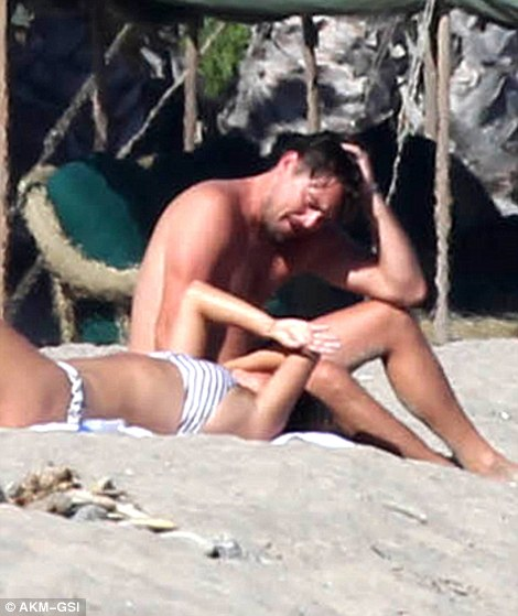 Smitten: The Oscar-winning actor only had eyes for his gorgeous girlfriend as they stretched out in the sand
