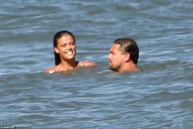 Beaming: The bathing beauty couldn't contain her happiness as she enjoyed a dip in the sea with Leo