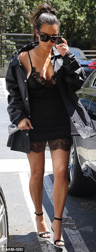Showstopper: The Keeping Up With The Kardashians star revealed almost all of her bare legs in the outfit that she paired with black sandal stilettos