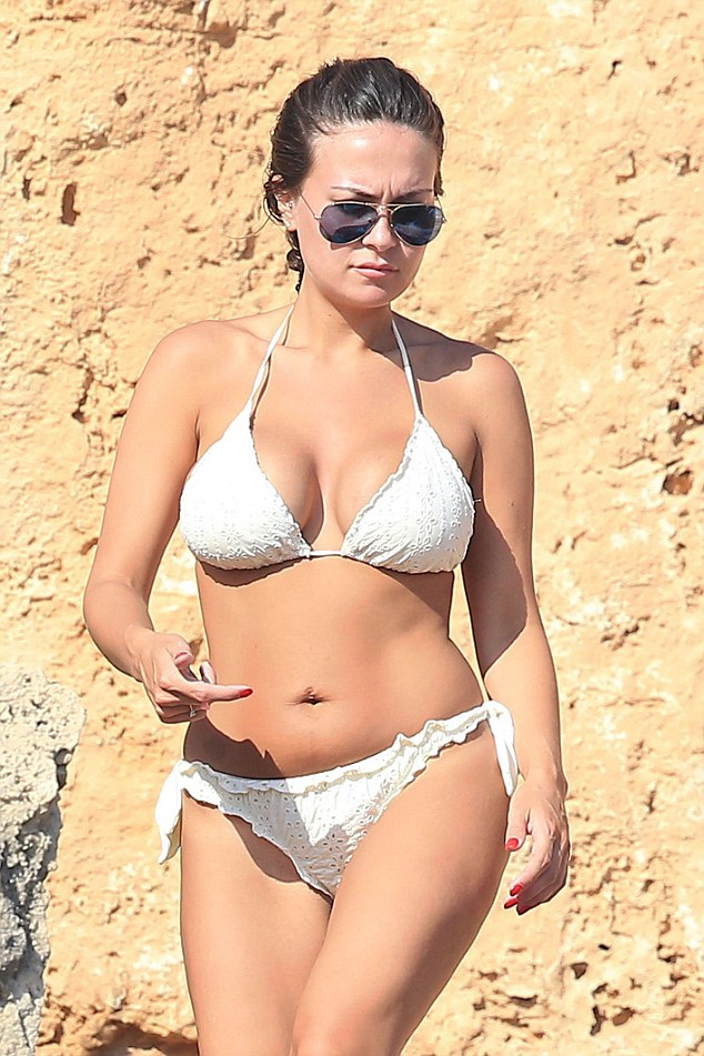 Sizzling! Emma flaunted her shapely figure in a halterneck bikini, which perfectly complemented her enviably golden glow