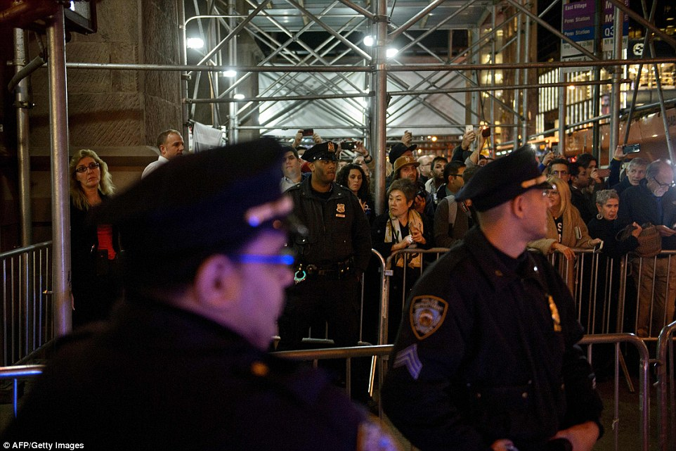 On guard: Cops surrounded the Peninsula Hotel on Tuesday night as Hillary Clinton took in the results. Clinton's staff had frozen out reporters as her failure became certain