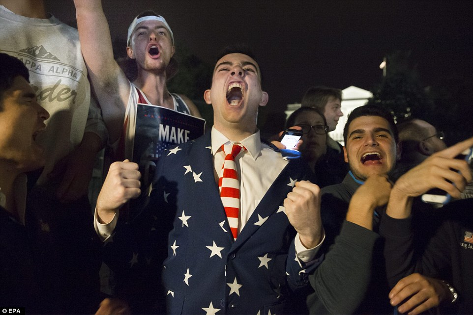 Cheers: Trump supporters let their joy be known on Pennsylvania Avenue outside the White House on election day, as their favorite romped home to victory