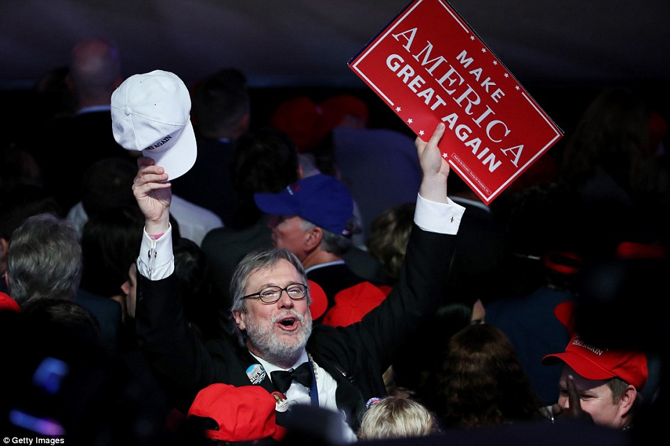 Celebration: This man was clearly elated as Trump romped home to a surprise victory