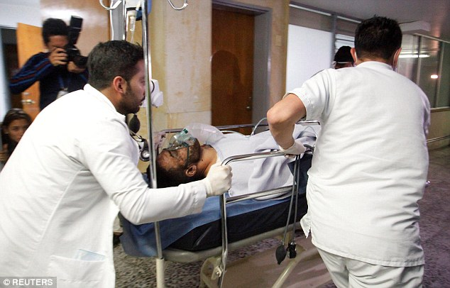 Ruschel (pictured on a stretcher) following the crash in Colombia last night