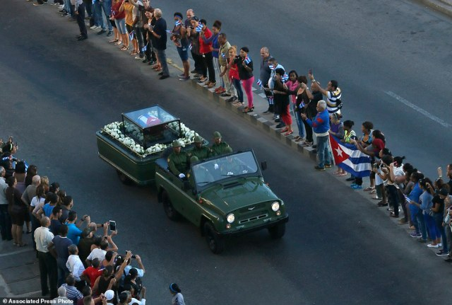 Placed in a small coffin covered by a Cuban flag the ashes of Cuban leader Fidel Castro are driven along the streets of Havana, Cuba, Wednesday