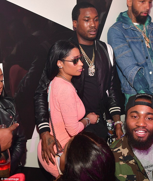 They got each other's back: Meek Mill was snapped with his hand on Nicki's derriere