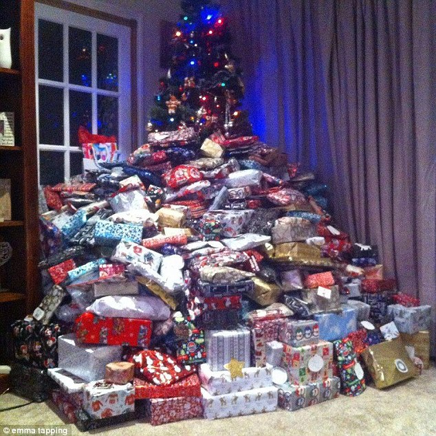 Last year she received widespread condemnation for showering her three children with 87 presents each, pictured, but this year she is going bigger