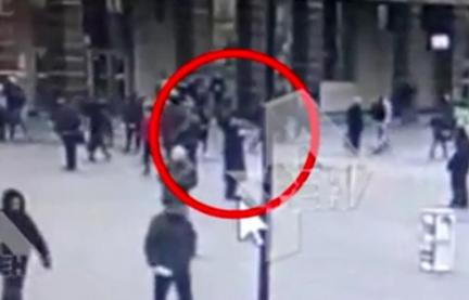 Pictured is the suspected bomber (ringed) outside a Metro station in the city of St Petersburg before the explosion