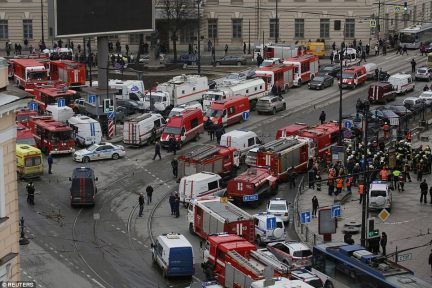 General view of the mass gathering of emergency services attending the scene outside Sennaya Ploshchad metro station, following explosions in a train carriage