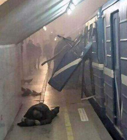 A man lies down on the platform after a bomb blast rips through a Metro carriage in the city of St Petersburg