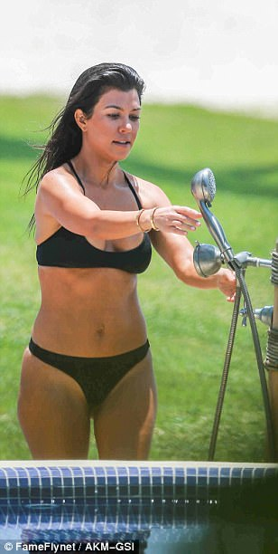 In shape: Kourtney has toned her middle to perfection