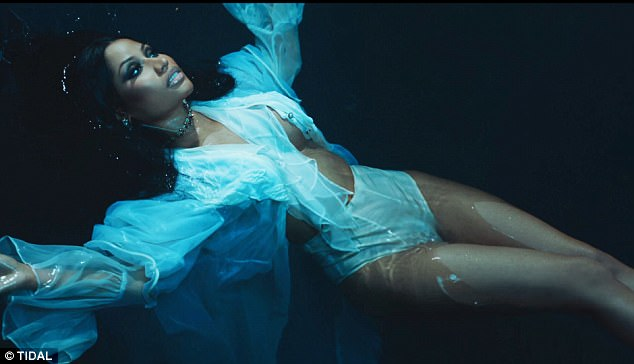 Ethereal:  The water images give off an other-worldly appeal as Nicki floats in dark water