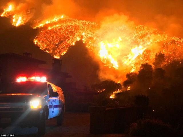 Thomas wildfire burns above Bella Vista Drive near Romero Canyon in this social media photo by Santa Barbara County Fire Department in Montecito, California, U.S. December 12