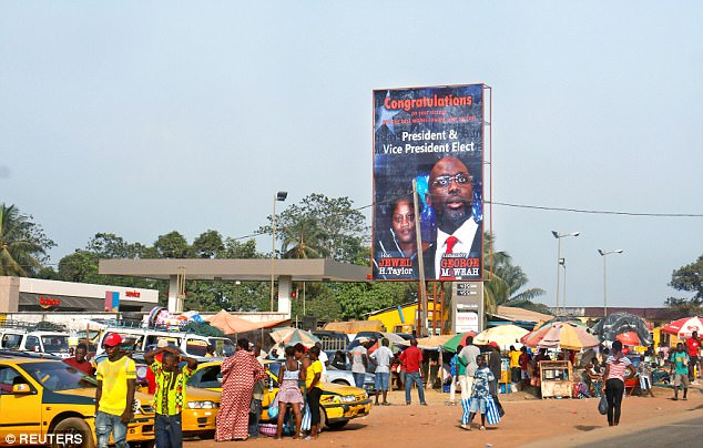A billboard of Liberia's new president George Weah is seen in a street in Monrovia