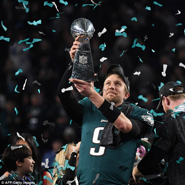 Nick Foles (pictured) said he gave 'all the glory to God' during the Super Bowl awards ceremony. The Eagles quarterback says he wants to be a youth pastor after the NFL