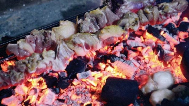 Customers can see mutton tikkas grilling on an open spit and chicken tossed with fresh tomatoes in block woks over smouldering charcoal - Photo by Khurram Amin