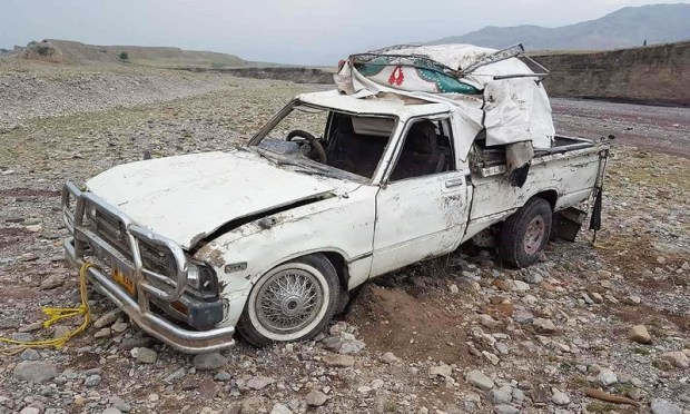 The van was damaged by flood water whilst carrying a groom's party in Bazar Zakha Khel in a remote village in Khyber. —AFP