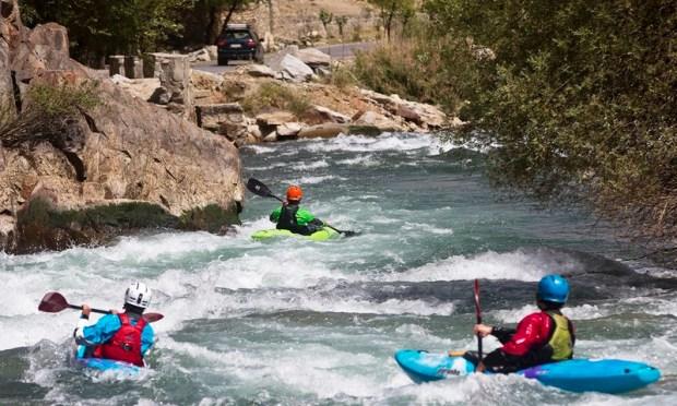 Three foreign tourists kayak along the Panjshir River in Panjshir province, north of Kabul, Afghanistan—AP