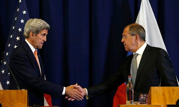 U.S. Secretary of State John Kerry, left, and Russian Foreign Minister Sergei Lavrov shakes hands at the conclusion of a joint press conference following their meeting to discuss the crisis in Syria, in Geneva, Switzerland, Friday.— AP