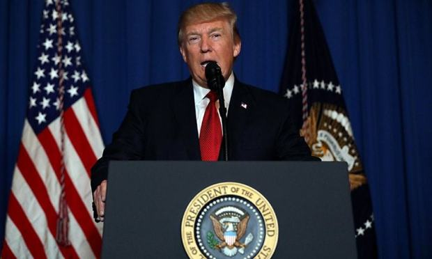 US President Donald Trump delivers a statement about missile strikes on a Syrian airbase, at his Mar-a-Lago estate in West Palm Beach, Florida, April 6.— Reuters