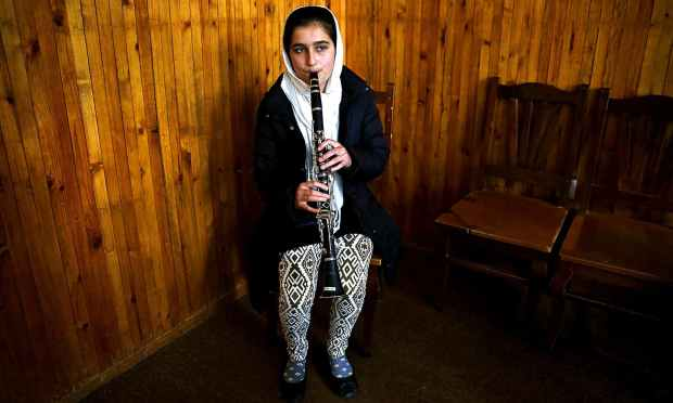 Sahar Malikzai, a member of the Zohra orchestra, practices. ─ Reuters